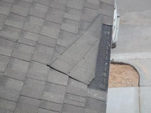 Wind lifted shingles